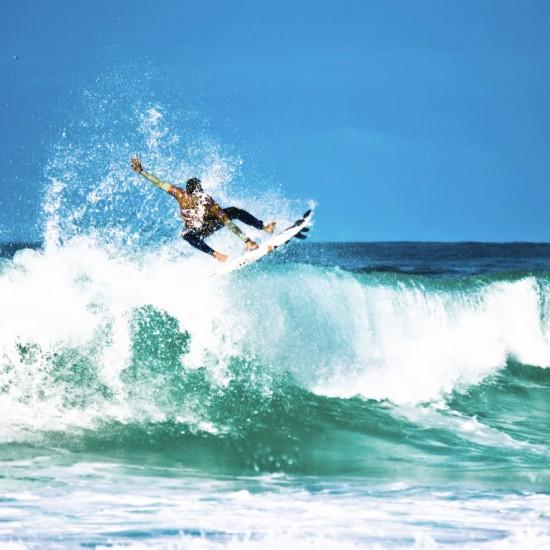 Surfer riding a wave in Hossegor